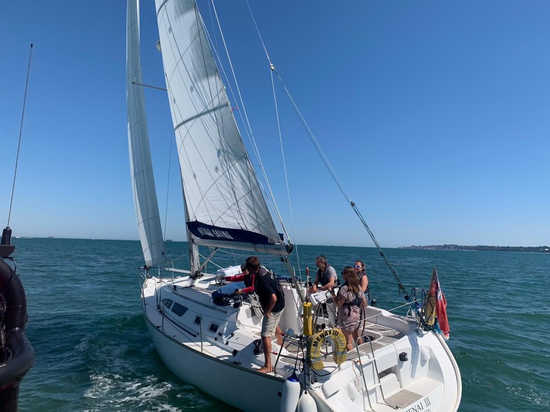 Crew on a sailing yacht during a practical sailing course
