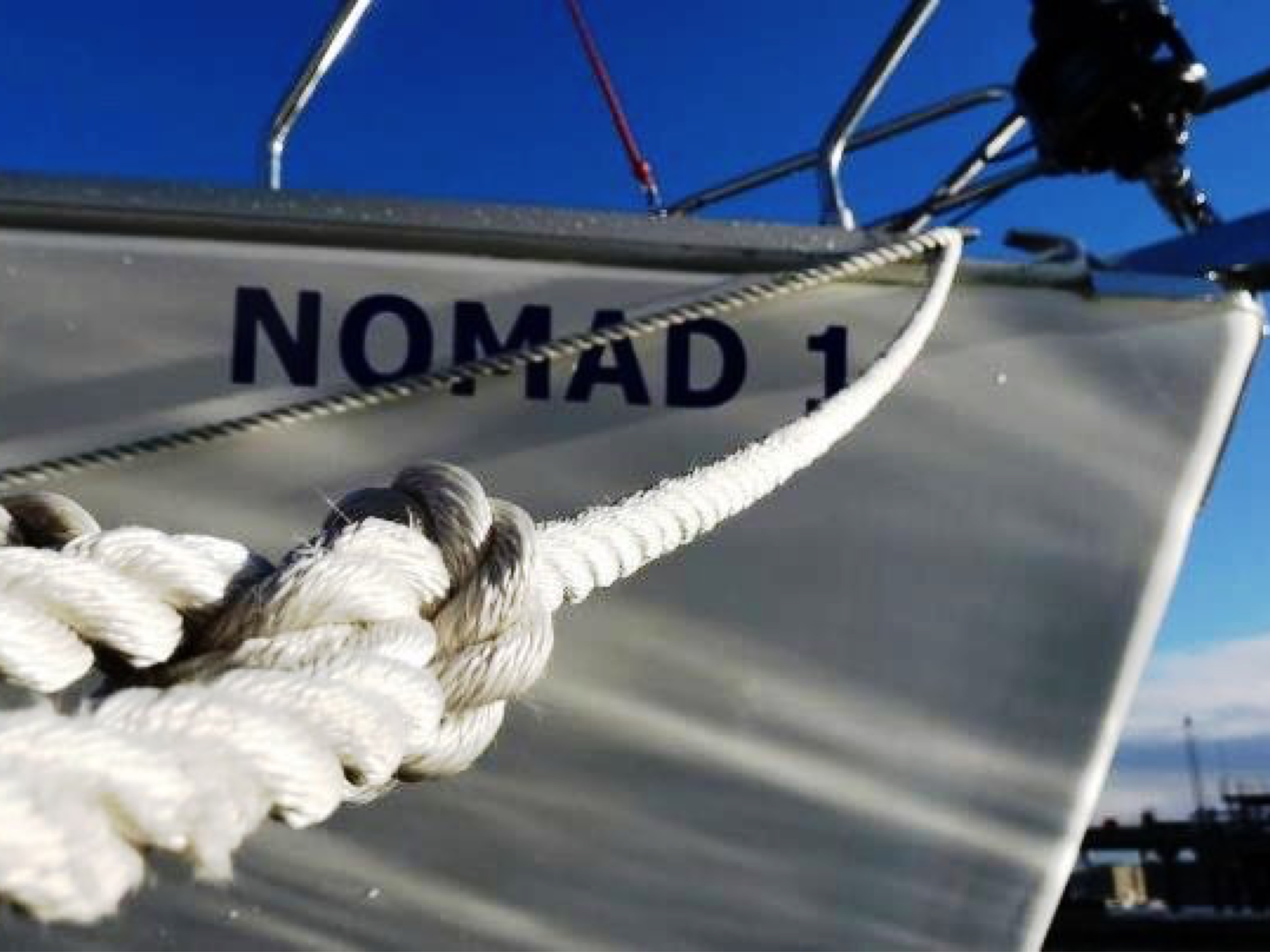 Image of the bow of Nomad 1 sailing yacht showing mooring line