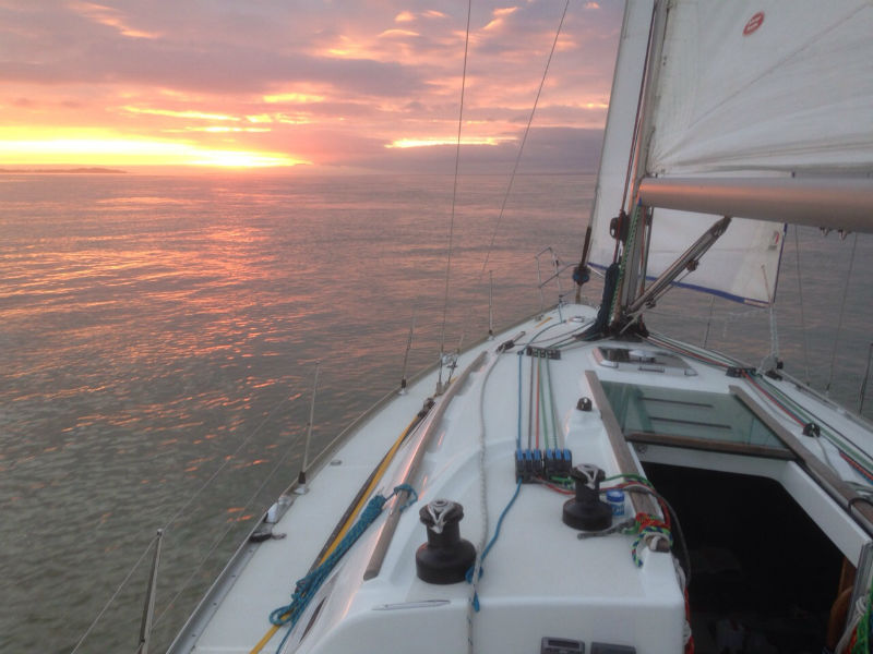 Photo of Nomad 1 Jeanneau Sunfast 37 sailing towards a sunset